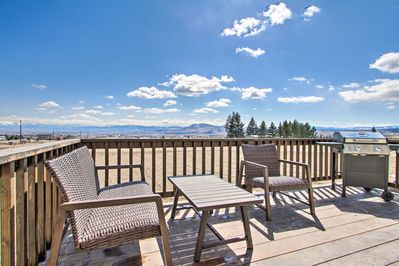 Admire the mountain views from the back porch of this vacation rental.