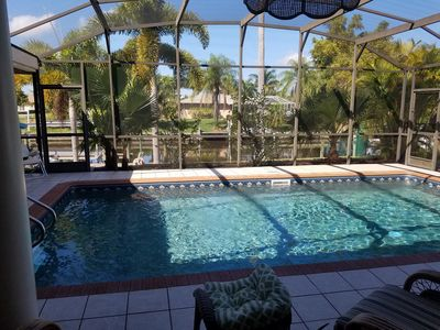 Photo for GREAT FAMILY GETAWAY with heated swimming pool located on a Gulf Access Canal