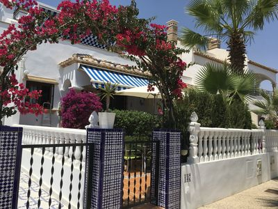 Photo for Luxury 3 bed pool side villa set in gardens.Near beaches and golf. Aircon /Wi-Fi