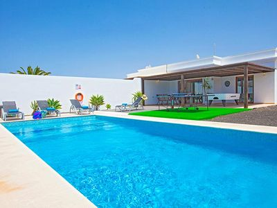 Photo for 3 bedroom Villa, sleeps 5 with Air Con, FREE WiFi and Walk to Beach & Shops