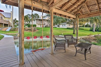 This central Florida home boasts a private boat dock & beach on Lake Placid!