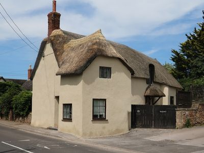 Photo for Beautiful C17th Thatched Cottage: WIFI, Woodburner, Enclosed Garden & Parking