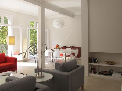 Living room and dining room with windows open