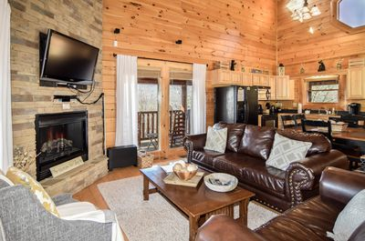 Beautiful rustic-chic open concept living room with 42 inch flat screen tv.