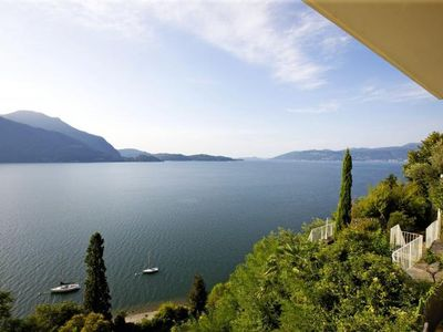 Photo for Partly antique furnished villa with pool and breathtaking view of the lake