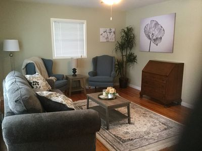 Large living room with comfortable furnishings. Make it home!