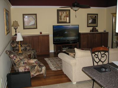 """Family Room. 60"""" Plasma TV w/ Suround Sound and BlueRay disc player."""