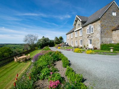Photo for Spectacular country house in tranquil Mid Wales countryside, boasting panoramic views over the Sever