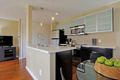 New and well stocked kitchen with Caesarstone countertops