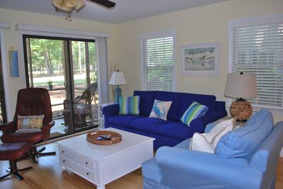 Living area with new sleeper queen sofa with view of 10th fairway