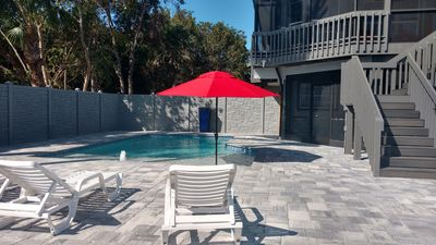 Photo for WATERFRONT HOME SLEEPS 8 4 BEDROOMS 3 FULL BATHROOMS POOL