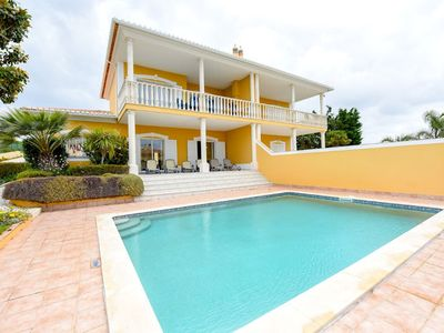 Photo for Comfortable, modern villa with stunning views of the sea at Praia da Luz. The three bedroom family v