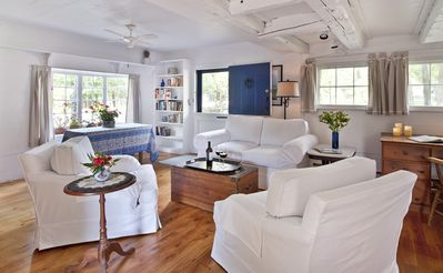 Living room with armchairs that swivel to face the couch or the flat screen HDTV
