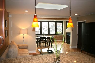 Family room, dining room with fireplace and lots of natural light