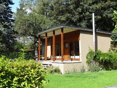 Photo for Nestled in a green scenery, this chalet along the river is perfect to chill out!