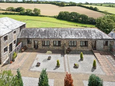 Photo for The Byre, 6 miles to Looe & dog friendly Seaton Beach, country retreat (1 BR)