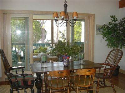 Dining area in Great Room opens into screened-in porch