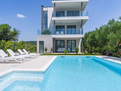 Photo for Modern ground floor apartment with private terrace, shared pool, outside kitchen