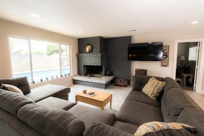 """Alternate view of living room.  65"""" smart TV hanging on the wall."""
