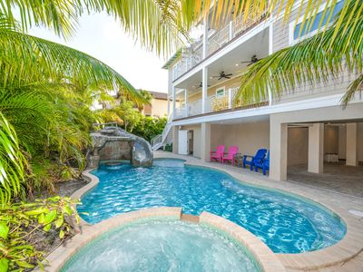 Photo for Massive 7 bedroom house one block off the beach,huge pool with waterslide