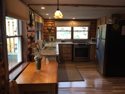 Updated kitchen with granite counters and great views!