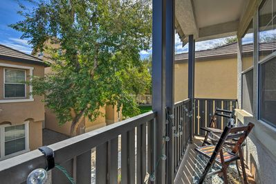 Amenities include a private balcony and access to a sparkling community pool!