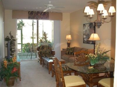 view of living & dining room / lanai in background