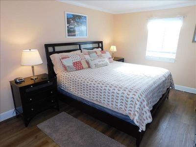 Photo for J4 Ocean Walk  is an upstairs two bedroom two bath unit with deck overlooking a large park and lake.  Close to clubhouse and front pool this unit has an open kitchen floor plan, tile floors in main living area, king and queen size beds.  Sleeps 4.