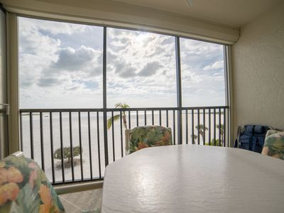 Photo for Peaceful Beachfront Condo! NEW casper mattress, heated pool, screened lanai