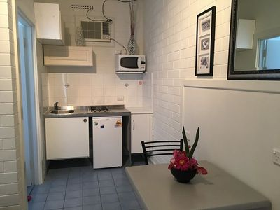 Kitchenette with gas Cook top, sink, microwave, fridge. All cooking utensils.