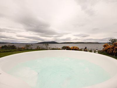 Relax in the eco- friendly wood fired hot tub and enjoy the amazing views