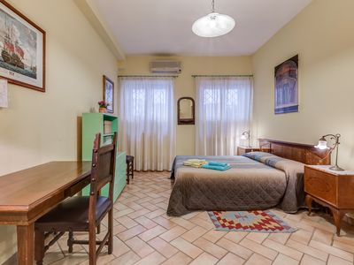 Photo for Casaglorioso Trastevere a Quiet Apartment in the Heart of Rome