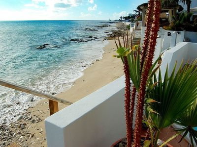 CARISMA on the BEACH... Totally charming beachfront 2BR in great location!