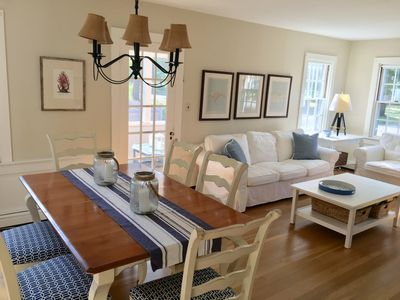 Combination living/dining room. French door leads to screened in porch.