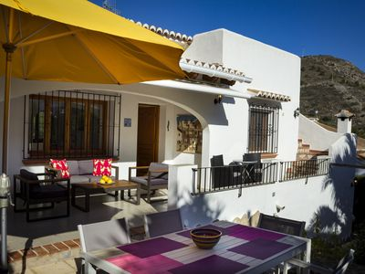Photo for Delightful family villa a short walk to El Portet with WIFI, TV and shared pool