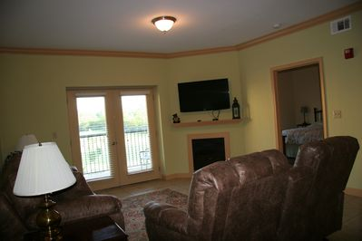 Living room area.  The love seat chairs are recliners.  Cozy fireplace