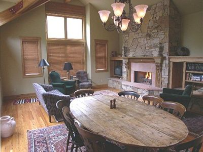 Living/ Dining area with vaulted ceiling and gas fireplace.