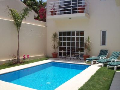 Swimming pool and lounging area - Suites Angelica