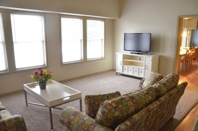 living room with a flat screen TV and an awesome view of the lake.