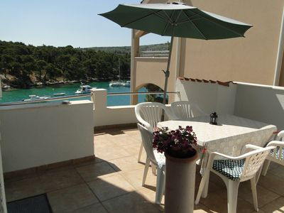 Photo for Holiday apartment by the sea with terrace and sea view