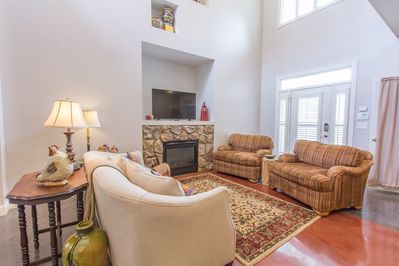 Two story ceiling creates beautiful natural light. Gas fireplace with remote.