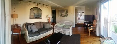 The living room has antique pine floors and great views of the river.