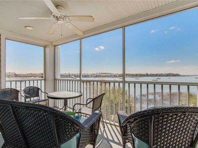 Photo for Enjoy Colorful Sunsets Over the River from the Screened in Porches!