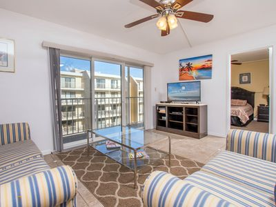 Photo for Enjoy full bay views from the entrance side of unit as well as a direct view of the outdoor pool
