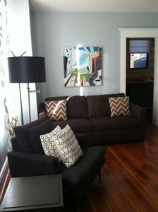 Comfy and clean living room with queen pull out sofa.