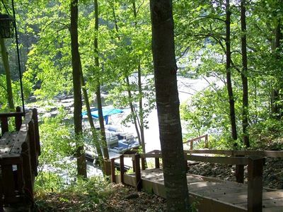 view of lake,is also a campfire pit, wood included ,about 25 steps to lake