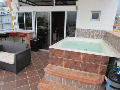Photo for 9 Bedroom including Penthouse Deck And good for fuctions by Lleras Hot Tub