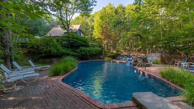 Photo for New Listing: Airy, Modern & Tucked into the Trees in Southampton w/ Private Heated Pool, Roomy Deck