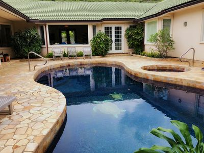 Pool, and jaquzzi from back of house. No child fence around pool