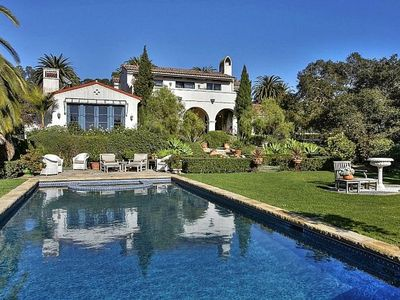 Gorgeous estate on exquisite 1.5 acre grounds only one mile from the beach.